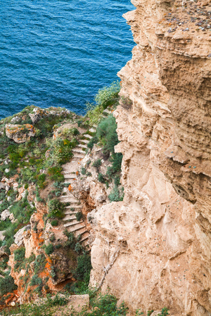 headland: Coastal cliff with old stone stairway. Bulgaria, Black Sea Coast, Kaliakra headland Stock Photo