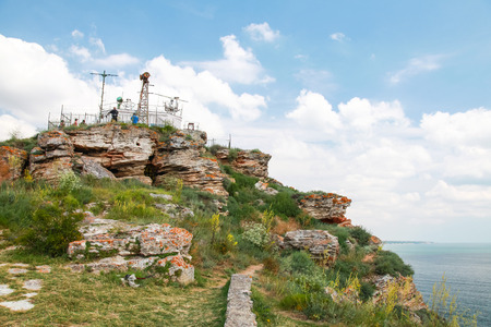 headland: Touristic viewpoint with ordinary tourists on the tip of Kaliakra headland, Bulgaria