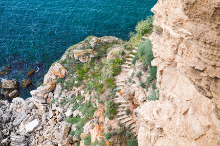 headland: Coastal cliff with stone stairway. Bulgaria, Black Sea Coast, Kaliakra headland Stock Photo