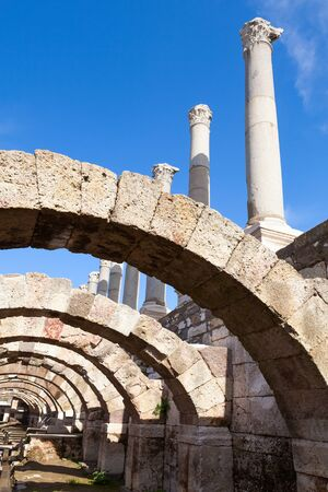 smyrna: Ancient columns and arches on blue sky background, fragment of ruined roman temple in Smyrna. Izmir, Turkey