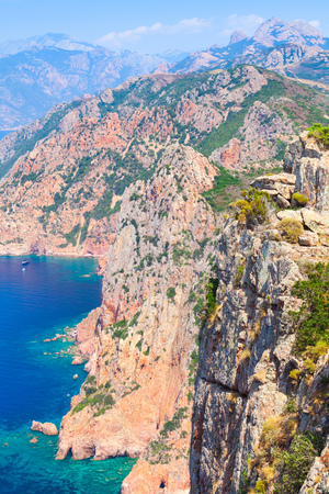 Rocks and sea in summer time. Vertical landscape of French mountainous Mediterranean island Corsica. Corse-du-Sud, Piana region