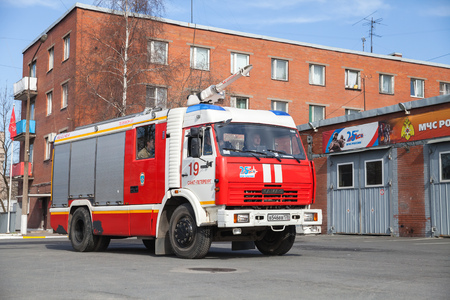 fire engine: St. Petersburg, Russia - April 9, 2016: Kamaz 43253 truck as a Russian fire engine modification near Fire Department garage