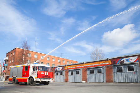 fire engine: St. Petersburg, Russia - April 9, 2016: Kamaz 43253 truck as a Russian fire engine modification with a running hose