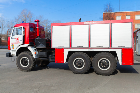 fire engine: St. Petersburg, Russia - April 9, 2016: Kamaz 43253 as a Russian fire engine modification, side view Editorial