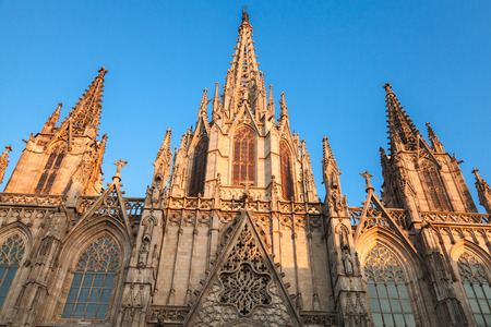 barcelona cathedral: Cathedral of the Holy Cross and Saint Eulalia or Barcelona Cathedral. Facade in warm evening sunlight
