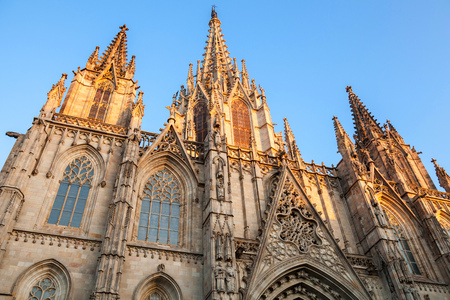 barcelona cathedral: Cathedral of the Holy Cross and Saint Eulalia also known as Barcelona Cathedral. Facade fragment in warm evening sunlight Stock Photo