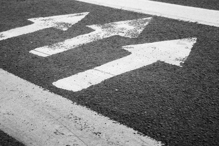 pedestrian crossing: Pedestrian crossing road marking with white arrows and lines on urban asphalt street