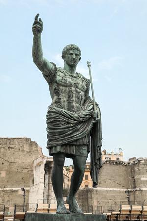 Ancient statue S.P.Q.R. IMP CAESAR Augustus PATRIAE PATER. Via dei Fori Imperiali street, Rome, Italy