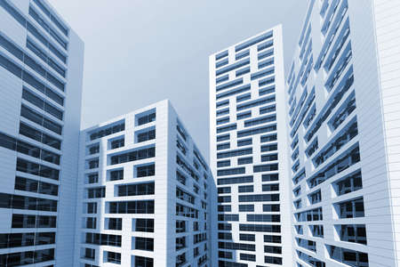 abstract building: Abstract modern city architecture.Cityscape of tall skyscrapers towers over blue sky. 3d render illustration