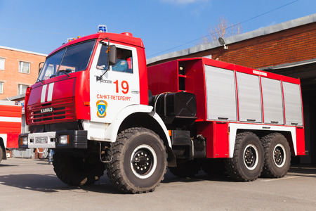 fire engine: St. Petersburg, Russia - April 9, 2016: Kamaz 43253 as a Russian fire engine modification drives out of the Fire Department garage Editorial