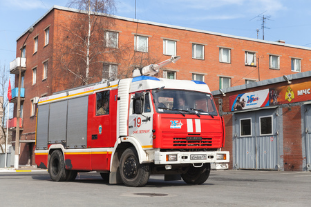 fire engine: St. Petersburg, Russia - April 9, 2016: Kamaz 43253 truck, red Russian fire engine modification near Fire Department garage Editorial