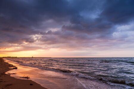 colorful cloudscape: Dramatic colorful cloudscape, Mediterranean sea coast at sunrise. Calafell resort town, Spain