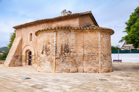 apses: Saint Michael church in Calafell, Spain. It is a work of transaction from Romanic to Gothic style, was shaped in XIII century, has two apses, one consecrated to St. Miahael, another to St. Mary Stock Photo