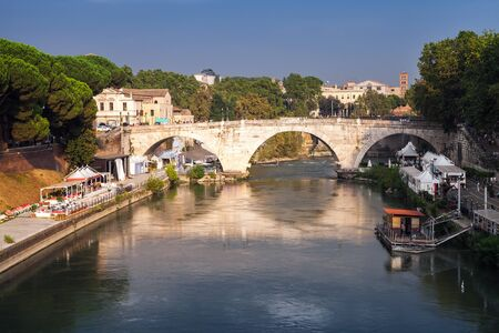 pons: Cityscape of Rome, summer evening. The Pons Cestius or Ponte Cestio in Italian is a Roman stone bridge in Rome, Italy, spanning Tiber river to the west of the Tiber Island