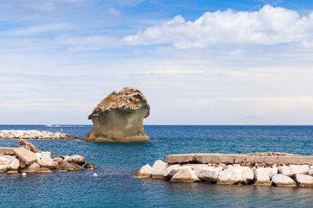 il: Il Fungo, famous rock in shape of mushroom in Lacco Ameno bay, Ischia island, Italy