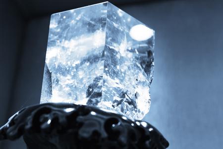 quartz crystal: Blue toned photo of natural transparent quartz crystal in cube shape, selective focus