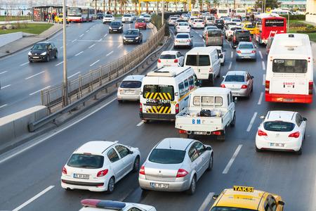 the traffic movement police: Izmir, Turkey - February 5, 2015: Different cars drive on the main street of modern Izmir city