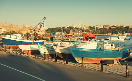 tonal: Wooden fishing boats in old Nesebar town, Bulgaria. Vintage stylized photo with warm tonal correction filter and selective focus Stock Photo