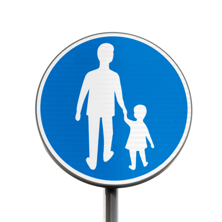metal pole: Pedestrians Only. Blue round road sign on metal pole isolated on white background