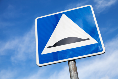 bump: Speed Bump. Square road sign over cloudy sky background Stock Photo