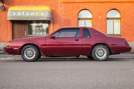 thunderbird: Porvoo, Finland - May 7, 2016: Red Ford Thunderbird ninth generation stands parked on the street. It is a personal luxury coupe built by Ford for the 1983 to the 1986 model years. Side view Editorial