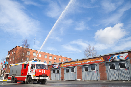 fire engine: St. Petersburg, Russia - April 9, 2016: Kamaz truck 43253 as a Russian fire engine modification with running water hose