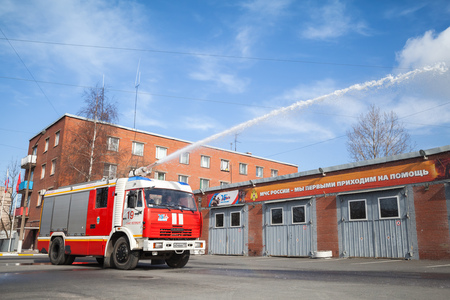 fire engine: St. Petersburg, Russia - April 9, 2016: Kamaz truck 43253 as Russian fire engine modification with running water hose