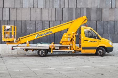 camioneta pick up: Vienna, Austria - November 4, 2015: Yellow service Mercedes-Benz Sprinter Crane W906 pickup truck