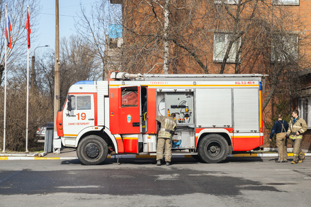 fire engine: St-Petersburg, Russia - April 9, 2016: Kamaz truck 43253. Modern Russian fire engine modification with firefighters checking equipment