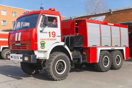 fire engine: St. Petersburg, Russia - April 9, 2016: Kamaz 43114. Russian fire engine modification drives out of the Fire Department garage