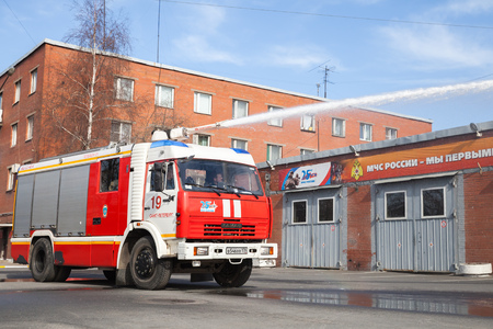 St. Petersburg, Russia - April 9, 2016: Kamaz truck 43253 as a Russian fire engine modification with a running water hose