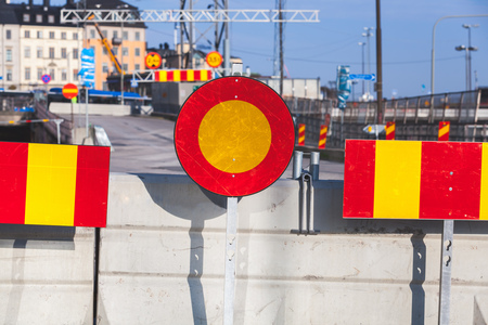 no way: No Way. Concrete street barrier with red and yellow warning signs