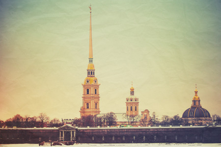 tonal: Peter and Paul fortress, one of the most popular landmarks of Saint-Petersburg, Russia. Vintage stylized photo with old paper texture and retro tonal correction filter effect