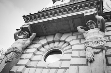 atlantes: Atlases as decorative elements of the facade of an old classical building in Saint-Petersburg, Russia Stock Photo