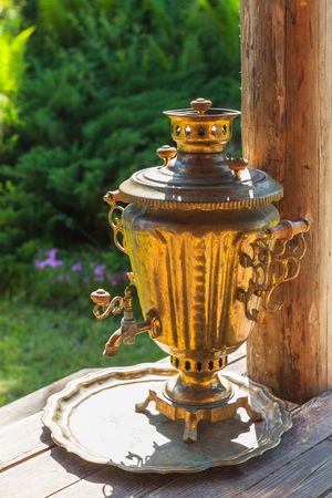 boil water: Traditional Russian Samovar, a metal container used to heat and boil water for tea ceremony