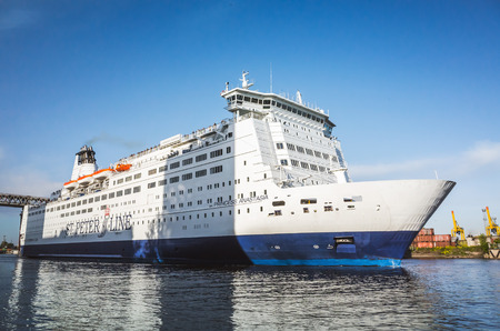 spl: St-Petersburg, Russia - June 7, 2016: White passenger ferry ship passing Saint-Petersburg Sea Channel near Kanonersky island. MS SPL Princess Anastasia is a cruise ferry owned by St. Peter Line