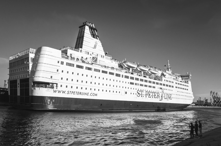 spl: St-Petersburg, Russia - June 7, 2016: White passenger ferry ship passing Saint-Petersburg Sea Channel. MS SPL Princess Anastasia is a cruise ferry owned by St. Peter Line. Black and white photo Editorial