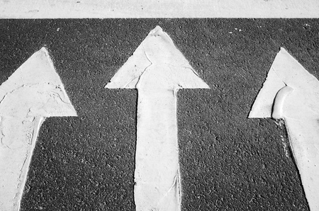 highway 3: White arrows on black highway asphalt, pedestrian crossing road marking fragment Stock Photo