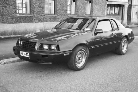 thunderbird: Porvoo, Finland - May 7, 2016: Ford Thunderbird ninth generation stands parked on the street. It is a personal luxury coupe built by Ford for the 1983 to the 1988 model years, black and white Editorial