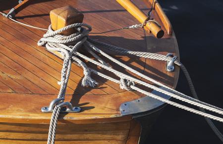 bollard: Wooden sailing ship bow fragment with bollard and mooring ropes Stock Photo
