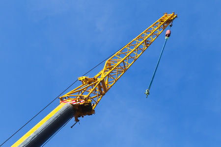 telescopic: Telescopic crane boom with hook hanging on chain