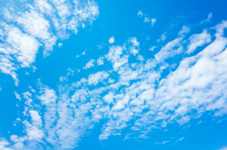 altocumulus: Natural bright blue sky with white altocumulus cloud layer, background photo texture