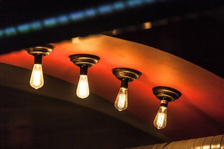 tungsten: Retro tungsten lamps glowing in dark interior, photo with selective focus and shallow DOF