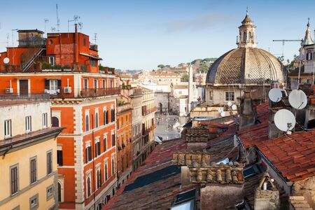 piazza dei miracoli: Old Rome, Italy. Via del Corso street view, photo taken from the roof, looking on The Piazza del Popolo with dome of Basilica Santa Maria di Montesanto as a dominant landmark