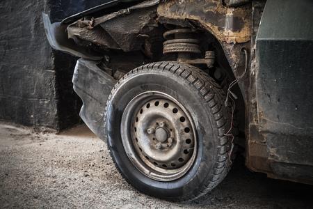 abandoned car: Abandoned rusted car fragment, old wheel