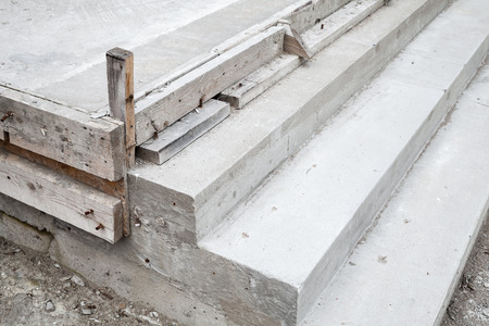concrete steps: White stairs under construction, concrete steps and timber forms