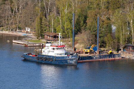 karl: Angsvik, Sweden - May 3, 2016: Swedish industrial tug Karl Alfred moored near floating pier