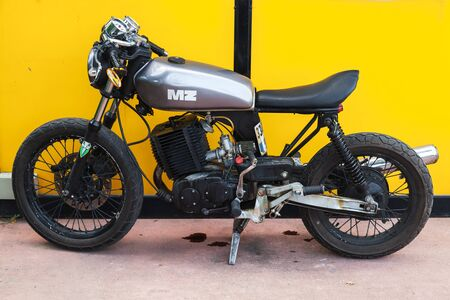 Istanbul, Turkey - July 1, 2016: Black German MZ motorcycle stands near yellow wall Editorial