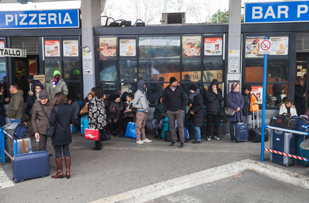 bus station: Rome, Italy - February 7, 2016: Passengers waiting a bus on central bus station in Rome Editorial