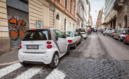 pedestrian crossing: Rome, Italy - February 13, 2016: Ordinary street in old Rome with cars parked near pedestrian crossing